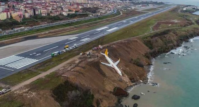 Plane skids off runway, stops barely metres from sea